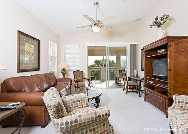 The spacious living room offers glorious tropical views - Tidelands 1942, 2 pools, spas, fitness center, wifi, Palm Coast - Palm Coast - rentals