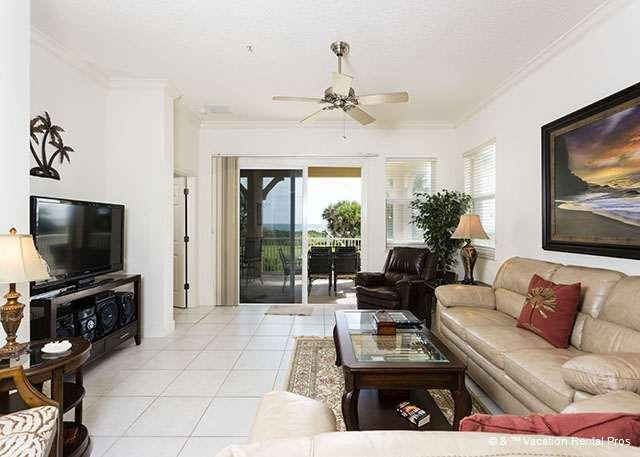 Tile floors and silent ceiling fans keep the living room cool! - 625 Cinnamon Beach condo, Oceanfront, 3 bedrooms, HDTVs - Palm Coast - rentals