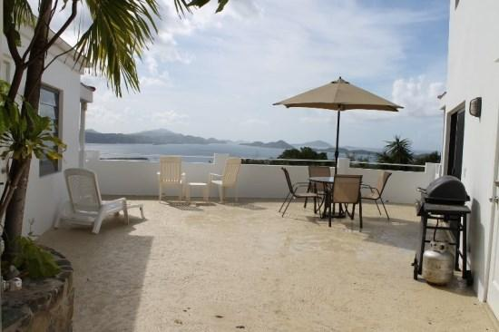 Private courtyard offers ocean views, BBQ grill, and seating/lounging areas - Sunset Ridge Villa B - Saint John - rentals