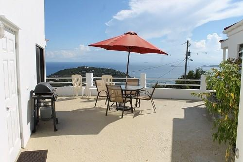 Private courtyard offers ocean views, BBQ grill, and seating/lounging areas - Sunset Ridge Villa E - Saint John - rentals