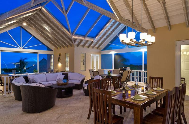 Evening captures the romance of the open concept great room under the stars - CASUAL CARIBBEAN ELEGANCE - RIGHT ON THE BEACH - Long Bay Beach - rentals