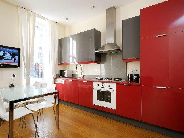 KITCHEN - fully equipped, modern design, red - Holborn Swimgym 2 Bedroom House with Garden - London - rentals