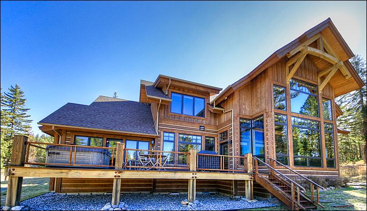 Exterior View of the Back of the Home - Big Deck with Hot Tub & Gas Grill - Eclectic, Stylish, & Luxurious Home - Located in the Exclusive Grey Drake Neighborhood (1055) - Big Sky - rentals