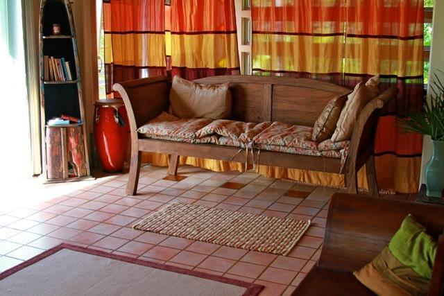 Sheer curtains separate the large living area into lounging and sleeping area - Paradise with Organic Fruit Trees! - Pahoa - rentals