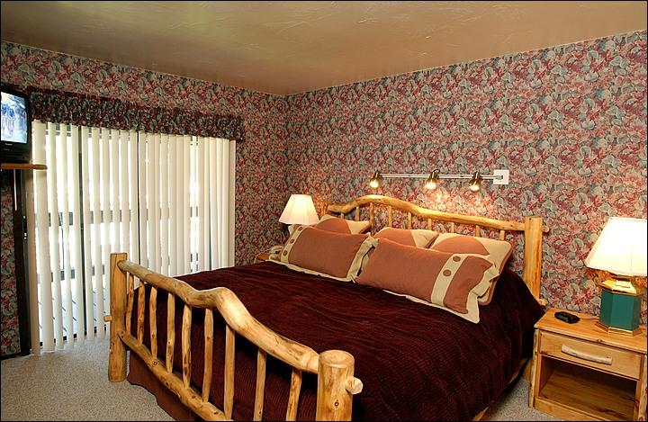 King Bed in the Master Bedroom (Representative Unit) - Cozy and Comfortable Condo - Beautiful Mountain Views (1119) - Crested Butte - rentals