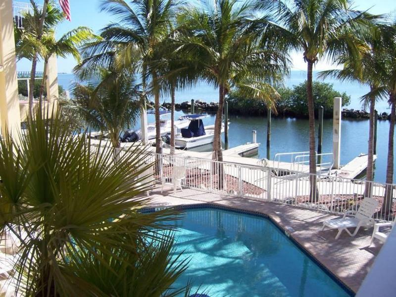 Nice view of the pool and boat docks - Fisherman's Paradise with a 30 Ft Boat Slip - Long Key - rentals