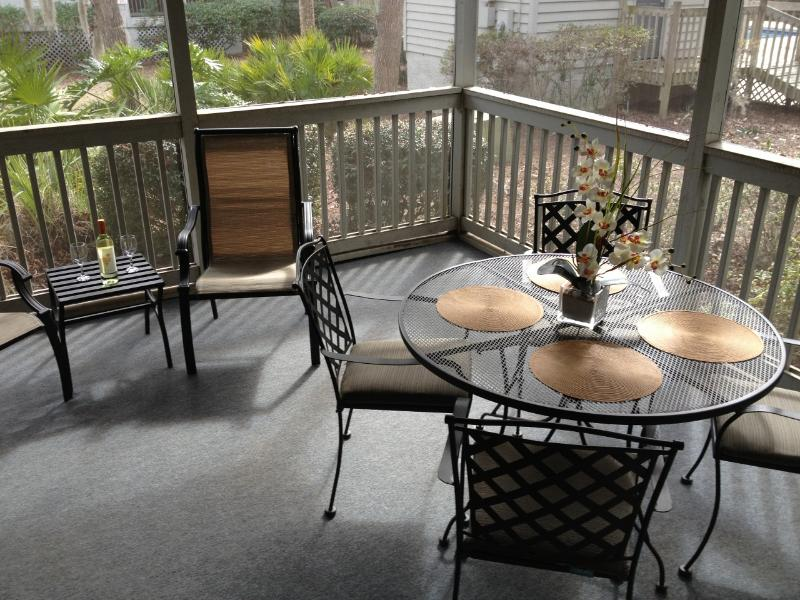 Relax & enjoy outdoor dining on our spacious screened patio - Cozy Remodeled Villa, Short Walk to Beach, Wi-Fi - Hilton Head - rentals