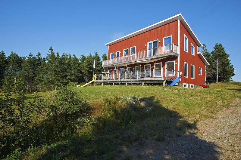 "Frontview tho the ""red"" house - Modern style ocean front home  Gulf of St Lawrence - Inverness - rentals"