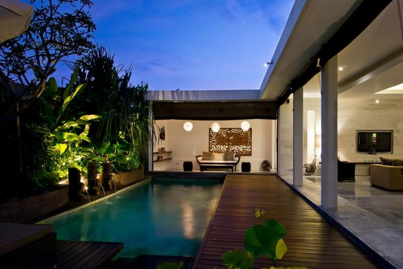 Lush gardens and timber deck surround the pool - WALK TO BEACH & KU DE TA, MODERN, BUTLER SERVICE - Seminyak - rentals
