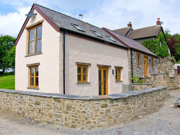 THE SMITHY, A luxury, split-level cottage with woodburner and woodland walks in - Image 1 - Carmarthen - rentals