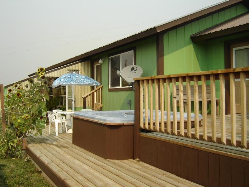 Our deck with out door table & chair plus hot tub - Cozy Teton Valley, Idaho Home - Victor - rentals