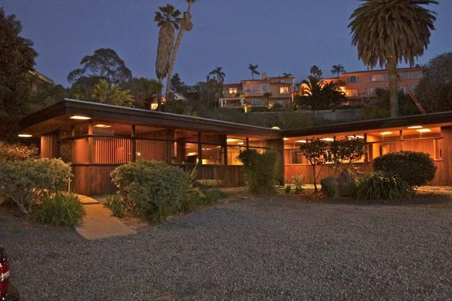 Front of Home in early evening. Large Palms are on the property. Integral carport just to the right - Mid-Century Modern Redwood and Glass La Jolla home - La Jolla - rentals