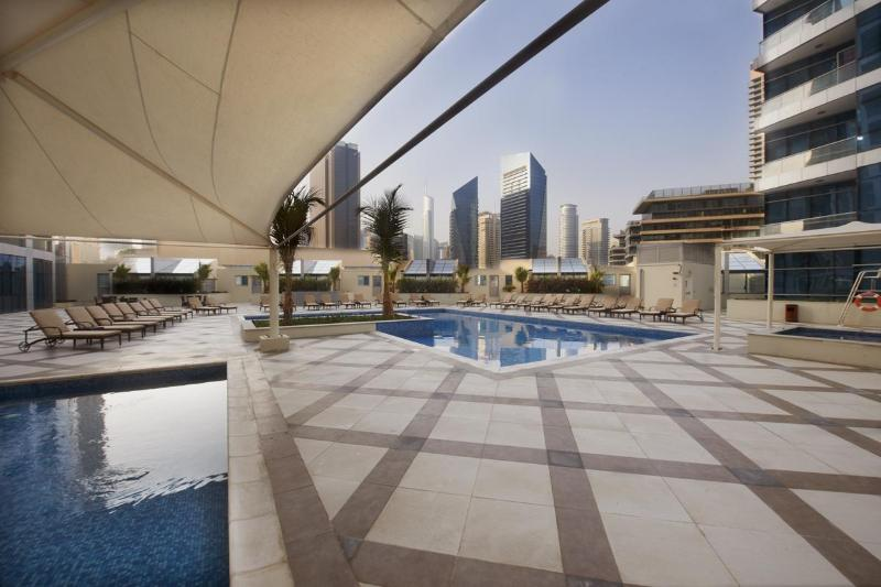 Swimming Pool with plenty of loungers - Stylish 4 Bed Apartment on Dubai Marina & JBR Walk - Dubai - rentals