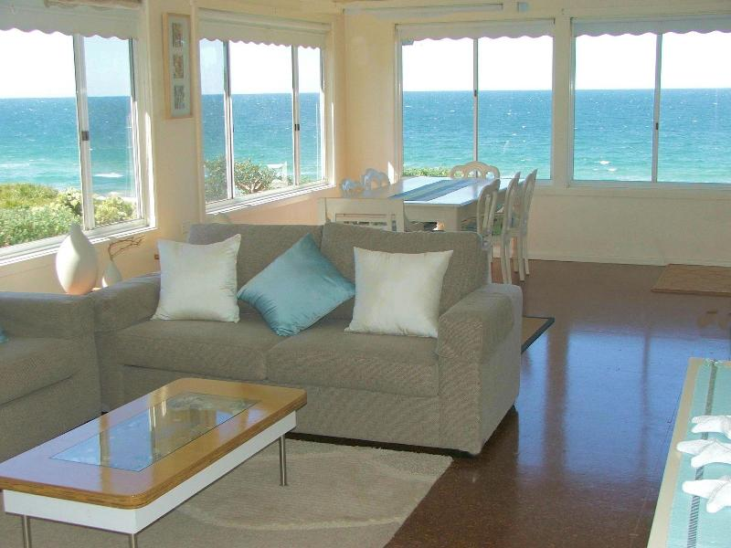 Living room looking onto Culburra Beach - The Beach House Culburra Pet Friendly - Culburra Beach - rentals