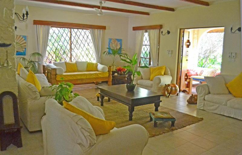 The living area leads out onto the gardens - Acacia Cottage - 3 Bedroom Watamu Home - Watamu - rentals