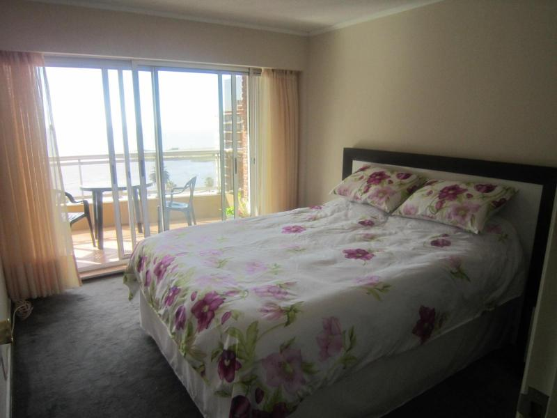 Master bedroom with terrace overlooking beach - Sunny beachfront condo in the heart of Montevideo - Montevideo - rentals