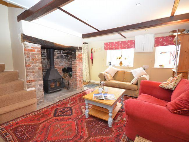 Cosy lounge with feature beams and woodburner - MILCO - Dorset - rentals