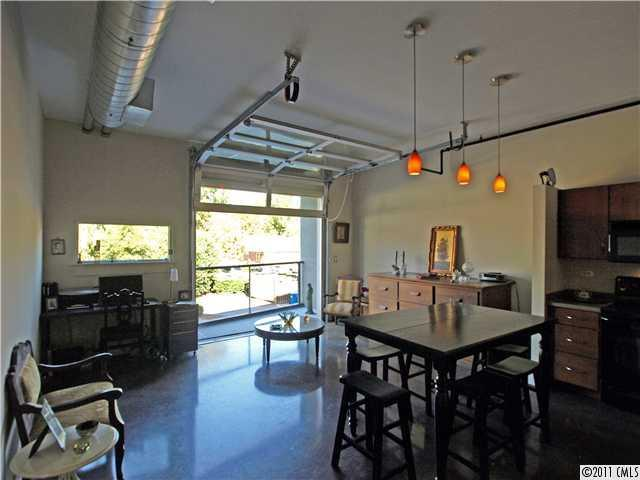 Open Living/Dining area and balcony - LOFT Condo in PLAZA MIDWOOD-Affordable Urban Flat - Charlotte - rentals