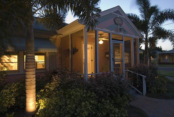 Night view of exterior - Gulfport Palm Cottage  - 3 houses from beach - Gulfport - rentals