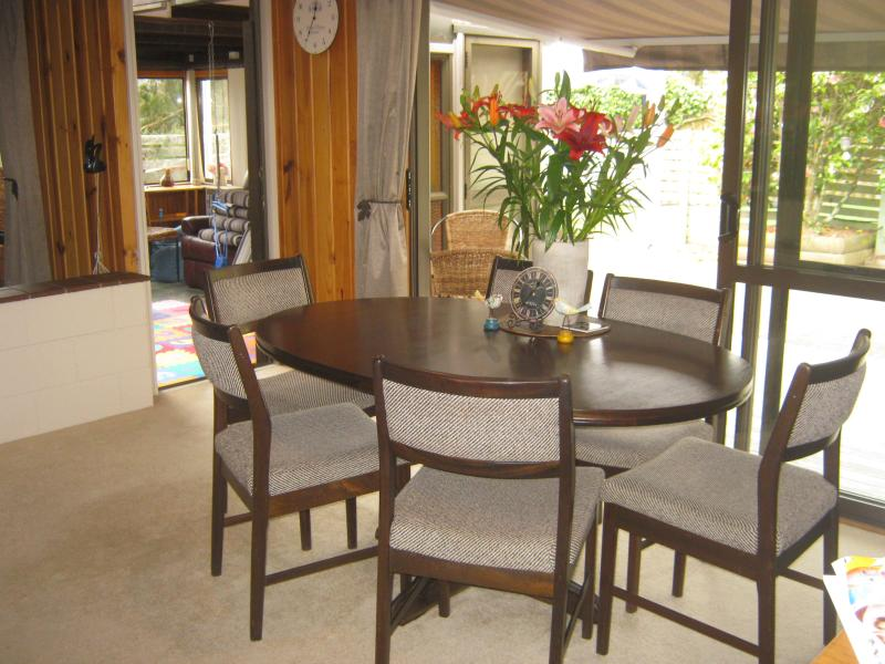 Dining room with Bifolds out on to the deck and back yard - very private and sunny. - 4 bedroom Family Home in Taupo -Close to lake/town - Taupo - rentals