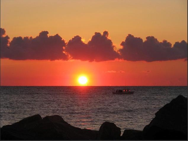 """Mitzi's Sunrise"" Guest photo taken from our seawall - Island Waterfront 1 Bd Full Kitchen & Ocean View - Hampton - rentals"