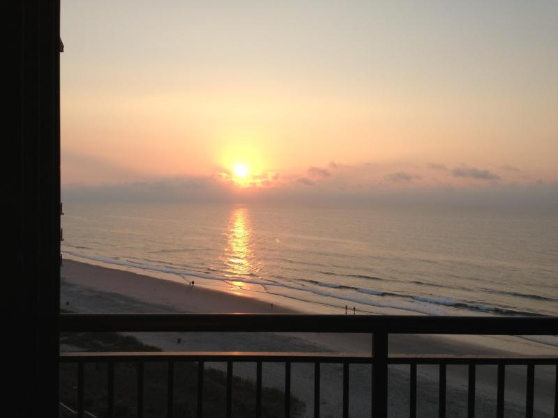 Drink your morning coffee and watch the sunrise from the balcony on the 10th floor. iphone photo! - Family-friendly oceanfront condo with 5 pools - North Myrtle Beach - rentals