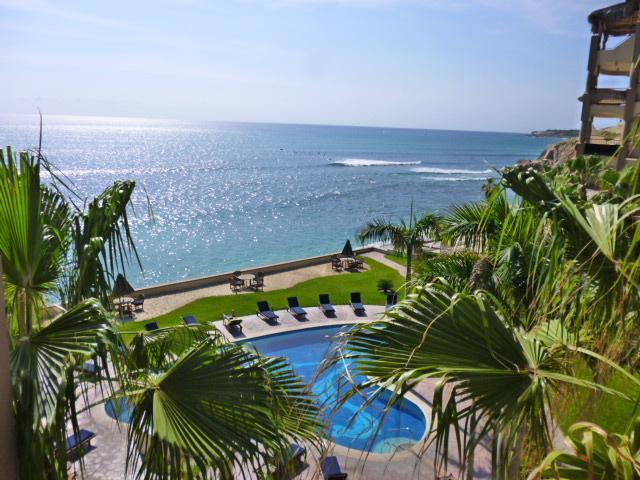 View from the balcony of the pool and the ocean. - Cute and Cozy BEACH FRONT 1 bedroom condo - San Jose Del Cabo - rentals