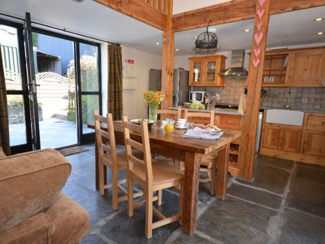 Open plan dining area with access to enclosed rear patio  - HIHID - Devon - rentals