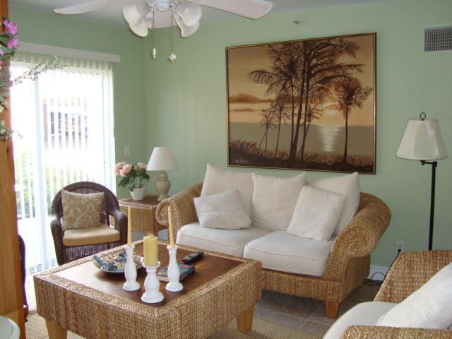 Living Room with TV/remote & access to patio - 3 bedroom condo in beautiful Indian Rocks Beach! - Indian Rocks Beach - rentals
