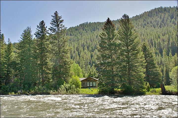Exterior View of the home from the conserved lands across the river. - Located Directly on the Gallatin River - Cozy & Comfortable, Great Value (1052) - Big Sky - rentals