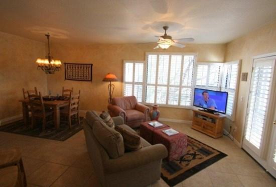 Living Room with Dining. View of Pool and Mountains from Window - Three Bedrooms and Two Bathrooms in Canyon View at Ventana Canyon Building 15 - Tucson - rentals