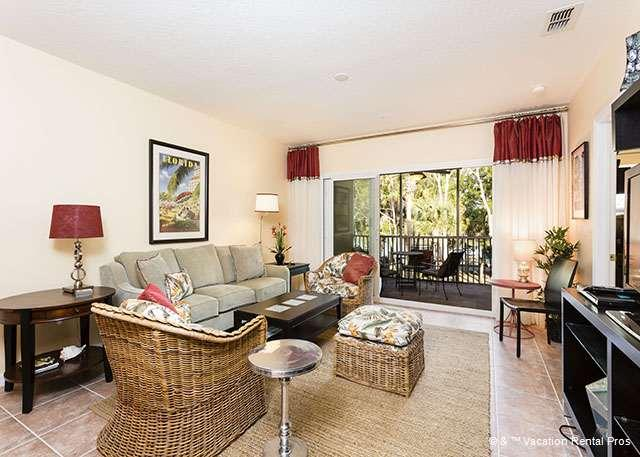 The living room is airy and pleasant - Canopy Walk 124, 2nd floor, 3BRs, Pool, Spa - Palm Coast - rentals