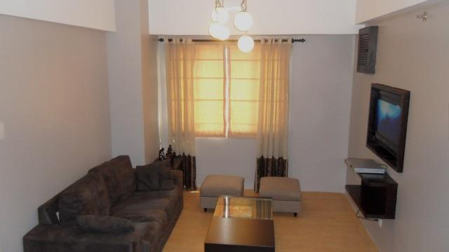 Living Room - 2BR, 2TB 60.5 sqm fully furnished unit in Eastwood (Eastwood Vacation Suites) - Quezon City - rentals