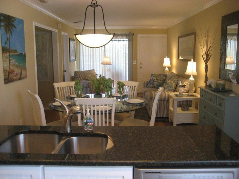 Kitchen looking to dining, living room and Gulf - 3 Bedroom Condo / Apartment - just steps to Fort Myers Beach - Fort Myers Beach - rentals