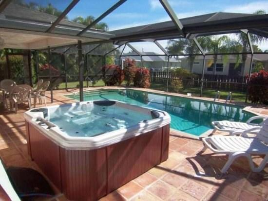 Front Elevation - Villa Yvonne - SW Cape Coral 3b/2ba Solar Pool, Electric Heated Spa, HS Internet, Southern Exposure, - Cape Coral - rentals