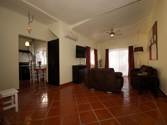 spacious living area with comfortable furniture and large flat screen cable TV - BUEN AIRE - 1 bedroom condo with 5th Avenue views! - Playa del Carmen - rentals
