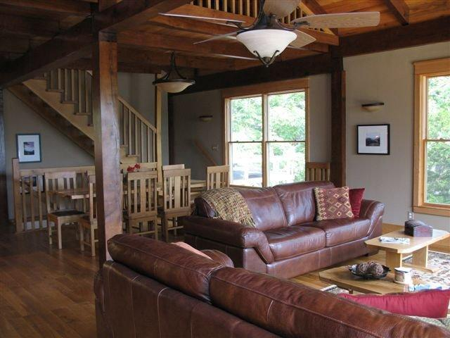 Half of the great room showing one of the dining area and the two full-sized couches. - Unique Post and Beam in Wooded Setting - Lake Ozark - rentals