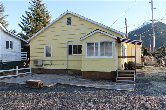 Side of Little Yellow House, showing new patio being built and entry - Little Yellow House - Sitka - rentals