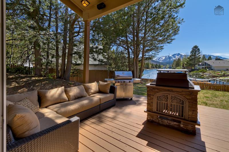 Take in the natural beauty surrounding you while warming up by the fire pit and lounging on the comfy outdoor furniture. - Waterfront home with hot tub and mountain views - Luxury Tahoe Keys Home - South Lake Tahoe - rentals