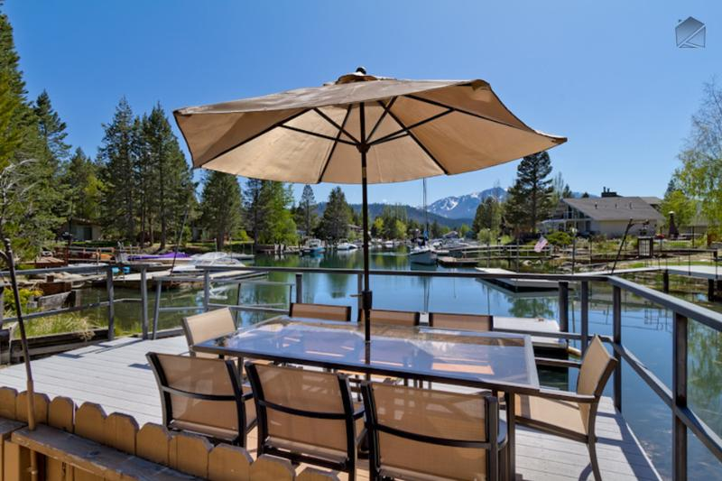 Eat the fish you just caught and cooked out on the deck table, which seats up to 8. - Waterfront home with hot tub and mountain views - Luxury Tahoe Keys Home - South Lake Tahoe - rentals