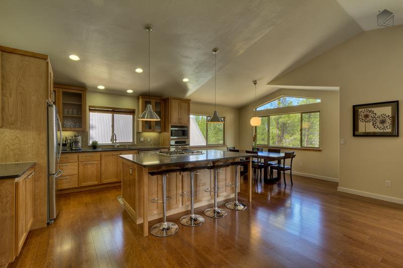 Gourmet kitchen has seating for 4 at the breakfast bar and opens up to living and dining area - Spacious 4 bedroom mountain home bordering national forest  - Contemporary Tahoe Cabin - South Lake Tahoe - rentals