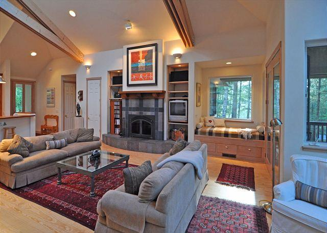 The great room is anchored by a beautiful wood-burning fireplace. - Cascade Trails on Orcas Island - Eastsound - rentals