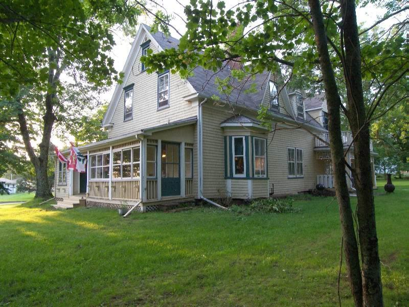 The front porch - Bulwinkles Place - Large Ocean front century home - Souris - rentals