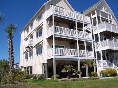 View of building 4.  Condo is the lower unit in building on left. - Large, Luxury Condo, Oceanfront Complex- 4a Becky - Ocean Isle Beach - rentals