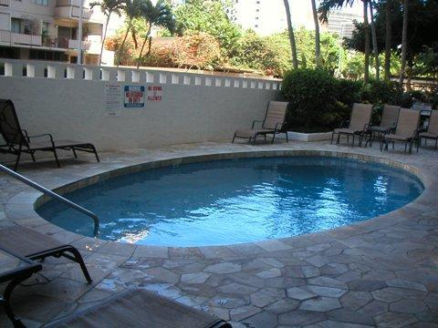 Shared community heated salt treated pool with lounge chairs, grill and tables! - Waikiki 2 Bedroom Condo - Honolulu - rentals