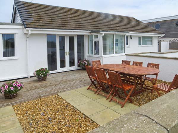 ST WINIFREDS, detached coastal single-storey cottage, pet-friendly, external garden room, parking, enclosed patio, in Rhosneigr Ref 20100 - Image 1 - Rhosneigr - rentals