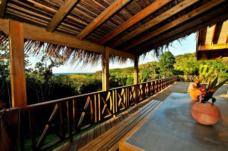 The main exterior dining area looking across the deck towards the sea and reef - Caribbean dream 4 bedroom 5 bath house sleeps 8+ - Bay Islands Honduras - rentals
