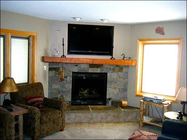 Large Flat-Screen TV and Gas Fireplace in the Living Room - Magnificent Year-Round Getaway - Walk to Shops & Restaurants (1271) - Crested Butte - rentals