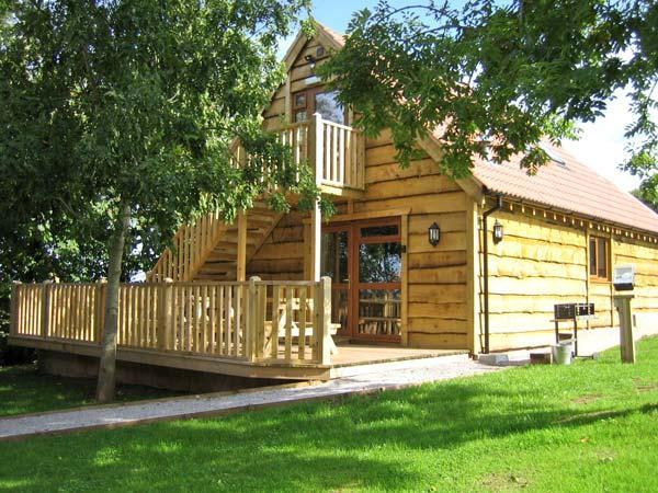 ASH LODGE, barn conversion, woodburner, wet rooms, hot tub, in Washford, Ref - Image 1 - Washford - rentals
