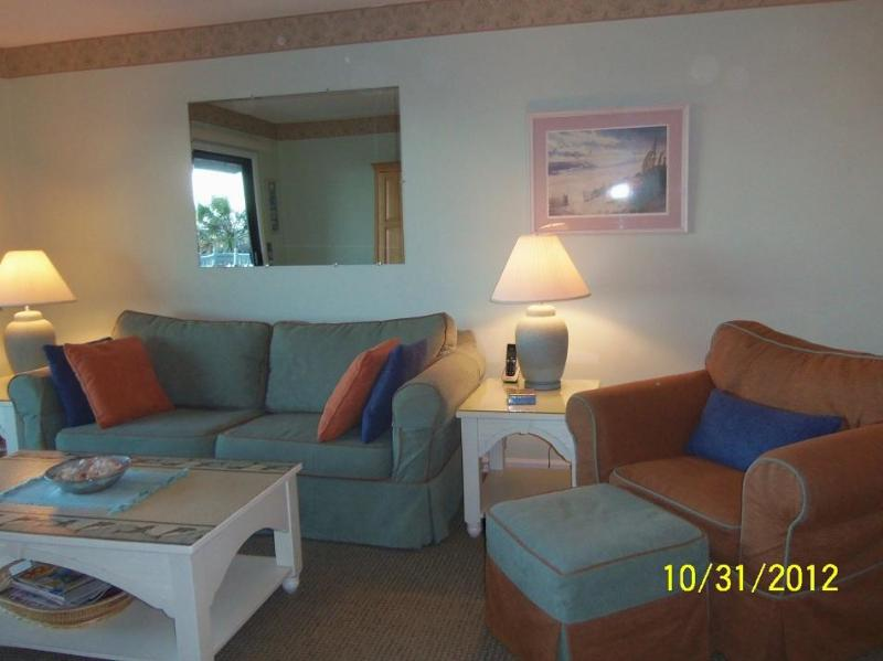 Living Room with sleeper sofa - Sands IV Unit 1A Beautifully Upgraded Condo - Carolina Beach - rentals